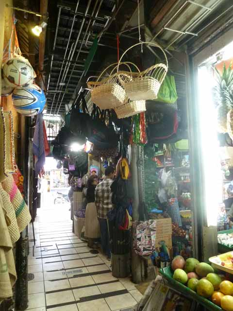 Corridor with baskets and fruit at Mercado Central