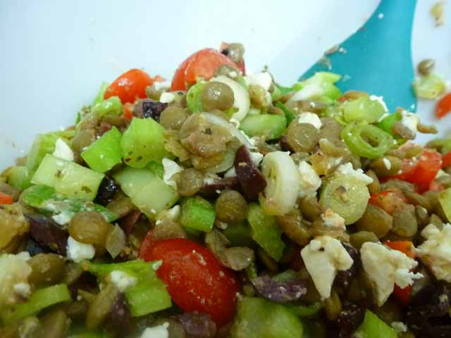 Mixing Greek Lentil Salad